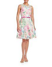 """<ul> <li>Vibrant floral details a mesh-accented style</li> <li>Roundneck</li> <li>Sleeveless</li> <li>Exposed back zipper closure</li> <li>Fully lined</li> <li>Includes removable belt</li> <li>About 21"""" from natural waist to hem</li> <li>Polyester/spandex</li> <li>Hand wash</li> <li>Imported</li> <li>This item will arrive with a tag attached and instructions for removal. Once tag is removed, this item cannot be returned</li> </ul>"""