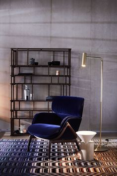 The Elysia lounge chair and Laurel side table by NICHETTO, Heron Brass floor lamp by CTO LIGHTING,  and the Suguaro rug by MISSONI HOME
