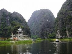 Sitting on boat cruising through Hang Ca, Hang Hai, Hang Ba with the scenic beauty of huge rocks standing along river and scattered green rice fields. You feel the tranquility, peace and all above, the nature combines with life of locals to form a poetic romantic painting of the countryside. - Vietnam 24h Tour Hoa Lu - Tam Coc Full day