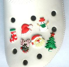 Christmas Shoe Charms 6 pc Set - Jibbitz Croc Style by Hermes. $5.99. Everyone loves Chrismas. And now you can put these favorite characters on the croc style shoes. This hard to find set comes with 6 charms. Collect them all, Mix 'n Match, trade your friends. Other Series Characters include: Super Mario Brothers, Star Wars, Kung Fu Panda, Sesame Street, Thomas the Train, Dora and more.