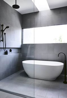 Amazing ideas for wet rooms: Top 12 - Contemporary and minimal bathroom Ultra-minimal and contemporary wet room, covered with square gray tiles in an oval bathroom and complete with Bathroom Design Luxury, Bathroom Layout, Modern Bathroom Design, Bathroom Ideas, Wet Room Bathroom, Bathroom Storage, Bathroom Mirrors, Master Bathrooms, Dream Bathrooms