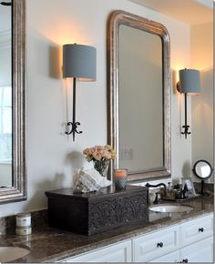 """{Cote de Texas: Ginger Barber Designed Townhouse}  """"Again, as in the kitchen, Ginger told me they decided not to remodel the bathroom, but instead make decorative changes such as add two antique Louis Philippe mirrors and a set of European sconces. She added this beautiful antique bible box – because she told me she doesn't like wide expanses of countertop. Another lesson learned! What a beautiful idea!"""""""