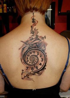 Spiral watch tattoo with music theme