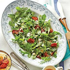 Arugula with Warm Bacon Vinaigrette | Mama always said, 'Eat your greens,' so start brunch off with a simple salad. The warm vinaigrette melts the goat cheese, creating a magical creamy dressing. | SouthernLiving.com