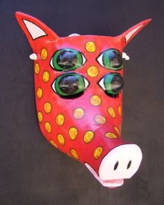 Paper mache masks from recycled paper and household discards. From Melvix. They are so colorful.