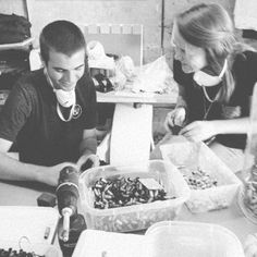 Interns sanding the bullets for our #fightinghunger necklaces