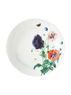 "Dinner plate decorated with an assortment of poppies and lush green leaves. Made of ceramic stoneware. Oven, microwave, freezer, and dishwasher safe. 11""Dia. Made in Portugal."