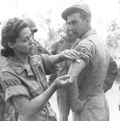 Army nurse Ernestine Koranda instructs Army medics on the proper method of giving an injection, Queensland, Australia, 1942. More than 59,000 American nurses served in the Army Nurse Corps during World War II.