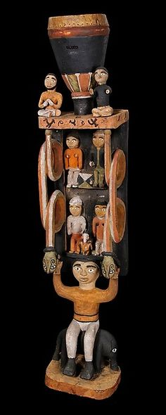Ceremonial Drum with Male Figure Holding Figurative Superstructure Seated on Elephant Date: 19th century, inventoried 1884 Geography: Democratic Republic of the Congo, Loango Coast; Cabinda, Angola; Republic of the Congo Culture: Kongo peoples Medium: Wood, pigment, hide Dimensions: H. 44 1/2 in. (113.1 cm), W. 8 7/8 in. (23 cm), D. 8 1/4 in. (21 cm)