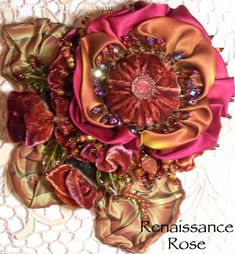 I ❤ ribbonwork . . . Renaissance Rose Corsage: This corsage is made similar to My Wild Gypsy Rose with a deeper Autumn pallet. The flowers and leaves were hand made with ribbons from hand dyed velvet ribbon, Hanah Silk Ribbon and French Wire Ribbon.   The corsage was embellished with beads and a glass button.