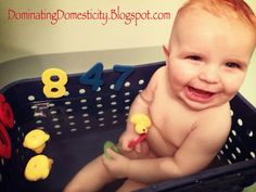 Laundry basket in tub to keep baby from hitting head on hard tub sides and keep toys close at hand!!