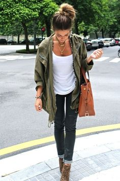 Great Simple But Beautiful Outfit. Plain White T-Shirt, Olive Green Jacket Over Top, Jeans Rolled Up, And High Healed Booties.