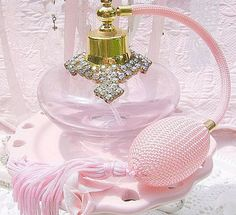 Vintage Bejeweled Pink Atomizer. It is so pretty. It reminds me of the one my mother had in her dresser. I used to ask her to spray me when I was a little one. Beautiful memories!