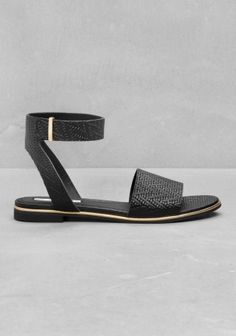 RICHARD BRAQO Made from beautifully embossed leather, these flat sandals have a wide front strap, and an ankle strap that closes with a brass buckle.