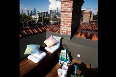 The Block 2012 - Brad and Lara's Rooftop Terrace; coloured cushions (bed, bath n' table red and aqua)