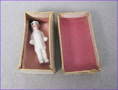 Frozen Charlotte in molded shirt, in her original box, with a pink blanket to keep her warm. 3cm.