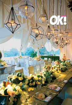 Mark's Garden designed the flowers for Hilary Duff and Mike Comrie's Montecito wedding using a neutral color palette including roses and dahlias in low-standing centerpieces. Vintage hanging lanters hung from the ceiling of the tent giving the reception a rustic garden party look.  Photo: OK! Magazine