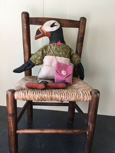 A personal favorite from my Etsy shop https://www.etsy.com/ca/listing/551924509/polly-the-primitive-puffin-doll
