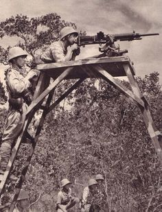 Japanese army personnel train and shoot targets with a type 92 heavy machine gun, 1942. 武士の島