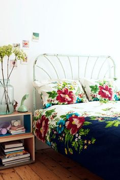 a whimsical bedroom.  i love that jar holding the flowers