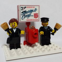 This is a lego version of my wife Kimberly and I ringing a bell for The Salvation Army.