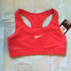 "NWT Nike pro combat reversible sports bra Red compression stretch reversible sports bra, white nike logo at front. Dri fit and compression technology to stay cool and for a locked-in feel. Elastic chest banding. Racer back with about 1-1/4"" straps. Recommended for medium impact activities. 88%poly/12% spandex, machine wash. Nike Intimates & Sleepwear Bras"