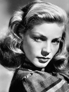 Lauren Bacall glancing at us with her perfect curls #50s                                                                                                                                                      More