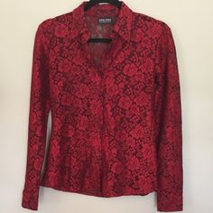 New York & Company Red Blouse  New York & Company beautiful red and black floral blouse. Long sleeve button front. Red flowers on red and black netting. Very pretty. Could be worn with black bralette or cami under. Very pretty deep bright red. Please note there is some wear on blouse between bottom two buttons. Made mistake of wearing belt over top without smooth back. See picture. New York & Company Tops