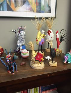 Colorful Folk Art brightens up this office shelf.