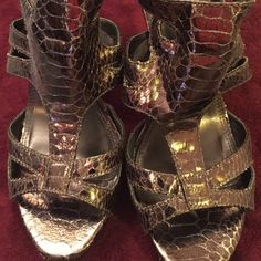 """Metallic Brown Heel 4"""" in w/ 1"""" platform, worn once. Small cut on right heel shown in the 4th picture. Chinese Laundry Shoes Heels"""