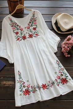 This floral embroidery loose dress featuring colorful embroidery, V neckline and loose sleeves design. Tribal fashion with platform sandals. Find this at JASSIELINE.com