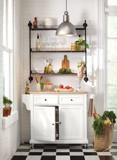 FOR THE A-TYPE STYLIST: A kitchen cart that looks as good as it functions plus a convenient wall shelf for extra storage.