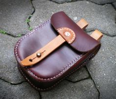 Made from Horween Chromexcel and vegetable tanned horse hide Most edges unfinished for a rustic military look Slightly concaved back to facilitate a flush fit against the hip The luster and pull up…
