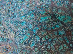 textured surface made using pva glue, kroma crackle, acrylic colours, and a heat gun