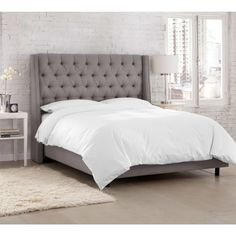 Loft living / tufted grey bedhead
