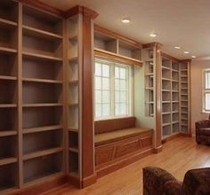Library wall -- painted shelves with window seat and cherry trim
