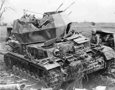 A American GI inspects the destroyed Whirbelwind anti aircraft tank after it was caught in the open by allied fighter bombers.