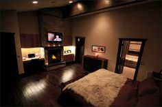 Master bedroom with a great built in wall unit for the fireplace, TV, storage and a small office space