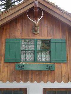 Super cute old school Scandinavian shutter & window box design and color.