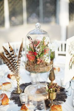 #feathers #cloche #terrarium Photography by alexandrameseke.com Floral Design by rebeccashepherdfloraldesign.com  Read more - http://www.stylemepretty.com/2012/11/19/brooklyn-botanic-garden-wedding-from-alexandra-meseke-photography/