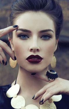 Made my jaw drop. Stunning makeup. Dark lips