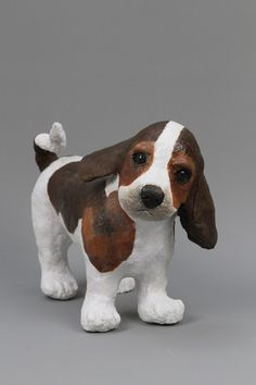 Sculpture papier mache of a standing beagle puppy. Unique piece handmade. It is painted with acrylic and covered with a satin varnish paint.