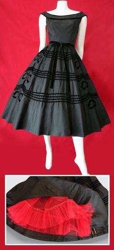 Coy, yet sexy! Stunning vintage 1950's black tafetta dress with velvet trim.
