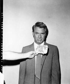 """This is a makeup and wardrobe reference photo of Cary Grant for scenes 48 and 49 of NORTH BY NORTHWEST (1959). Note that this is how he was made up to look """"hair mussed + drunk""""."""