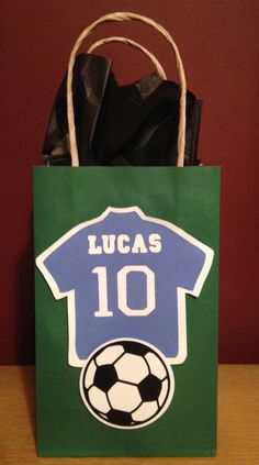 Soccer Goody Bags I made for the boys in Lucas' 4th Grade Class. Blue Jerseys, with their name and the #10 in honor of his 10th Birthday, and of course, a soccer ball. Lucas' 10th Birthday 2014