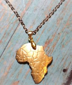 """<p>With this eye-catching gold-plated necklace, you can now show the world just how much you love the beautiful continent of Africa!</p><p>Chain length: 18"""" inches</p>"""