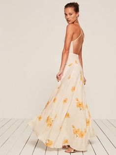 For summer weddings or also just summer. This is an open back, floor length dress with adjustable, cross-back straps and a center back zipper.