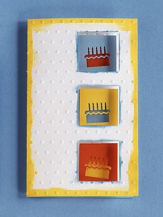 Birthday Cards for Him: A raised decoration and some clever cake cutouts give this birthday card a creative edge. Use blue and yellow paint to draw attention to the edges of the card and the three square cutouts. Punch the cakes out of different colors of paper and back them alternatively on red, blue, and yellow on the inside of the card.