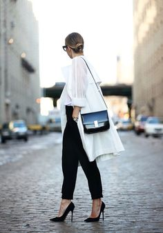 Chic Classic OUTFIT: Tucked White Blouse + Loose White Sweater + Loose Fitting Black Trousers (Rolled up pant Leg) + Simple Small Black Bag + Black Sunglasses + Black Pointed Toe Heels/Flats + Gold Jewelry + Hair in Bun + POP of Red OR Fuchsia Lipstick!