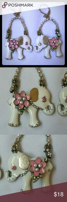 """NWOT Betsey Johnson White Elephant Dangle Earrings Beautiful New without tags, never worn, Betsey Johnson pink, white, and gold enameled earrings with a pearl necklace,  pearl accented flower with light green crystal leaves, diamond crystal accented bird on its rump, and pink rhinestone crystal eye. The metal is high polish gold, double suspension diamond rhinestone chains and top accent with leverback ear hardware. Measures 1.75"""" long, 1 1/8"""" wide.  Thank you for checking out my closet, and…"""
